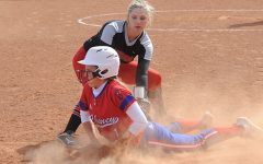 Softball Sweeps One Twinbill, Loses Another
